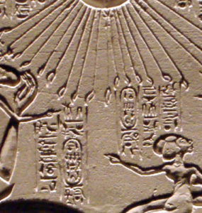 A house altar showing Akhenaten, Nefertiti and three of their daughters.