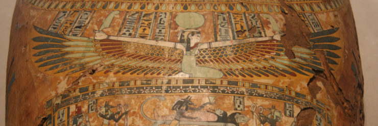 The goddess Nut with her wings stretched across a coffin.