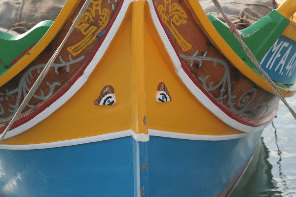 A Maltese Luzzu (traditional fishing boat from Malta) painted with the protective eyes.