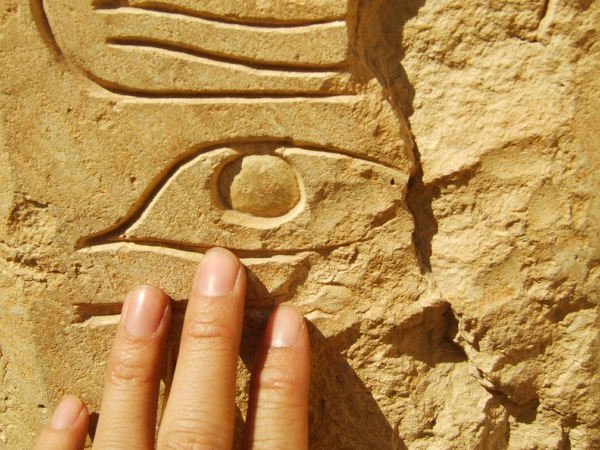 The Eye of Horus carved into a stone wall.