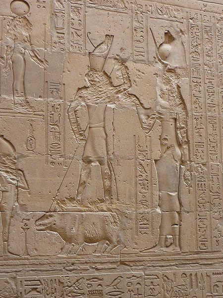 A wall relief of the fight between Set and Horus where Horus, helped by Isis, kill Set while in the form of a  hippopotamus.