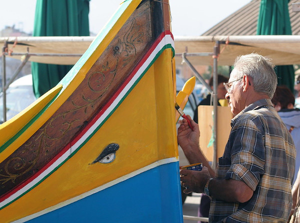 A Maltese fisherman adding the final touches to his boat.