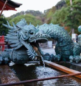 An azure dragon perched atop a water trough.