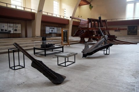 An ancient roman anchor and rudder inside the archaeological museum of nemi in italy / Symbol of Laetitia.