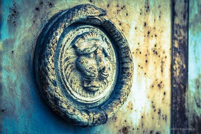 Ouroboros on a cemetery door.