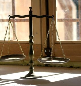 The beam balance since ancient times has come to signify fairness, justice, balance, and non-discrimination.