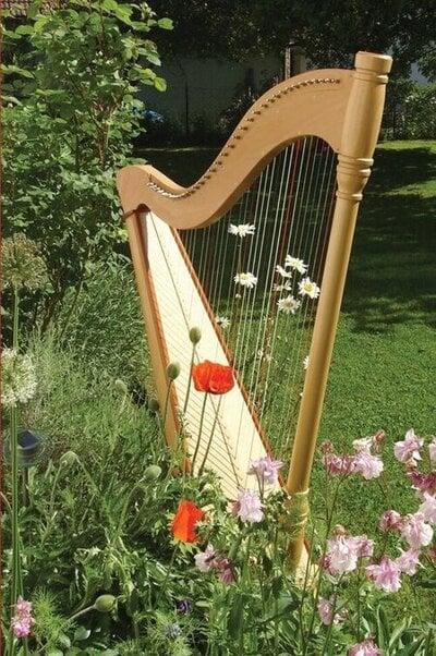 A harp kept in a garden.