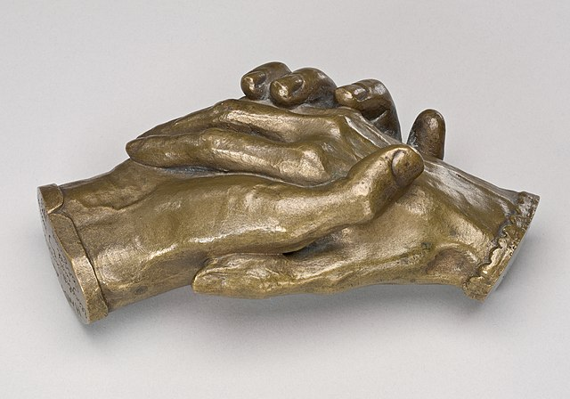 Clasped hands.