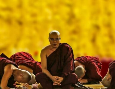 Buddhist monks bow in respect